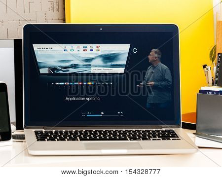 PARIS FRANCE - OCT 28 2016: Apple Computers website on new MacBook Pro Retina with OLED Touch bar in geek creative room showcasing Apple Keynote - Philip Schiller talking about new speccs Touch Id Oled Bar