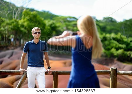 Young couple sightseeing Chamarel seven coloured earths poster