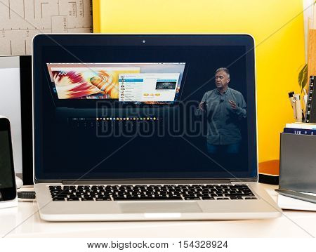 PARIS FRANCE - OCT 28 2016: Apple Computers website on new MacBook Pro Retina with OLED Touch bar in geek creative room showcasing Apple Keynote presentation of Oled bar integration with skype