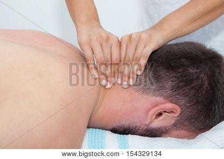 masseur giving neck massage
