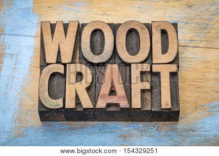 woodcraft - word abstract in vintage letterpress wood type against grunge wood