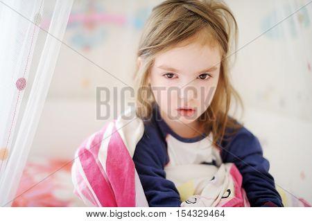 Little Preschooler Girl In Pajamas On Morning