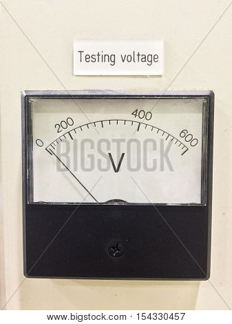 Old style voltmeter gauge. Voltage meter of test room for measurement voltage on controller panal. Testing voltage scale 0-600 Volts.
