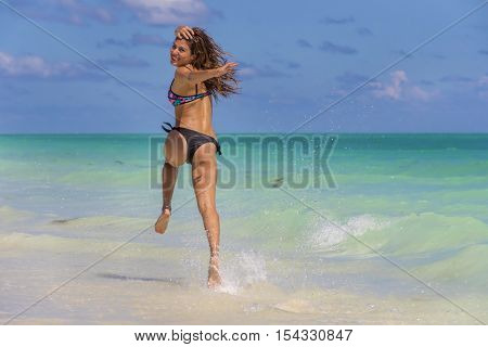A hispanic brunette model enjoying the beach