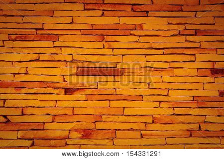 Backdrop of old stone brick wall texture.