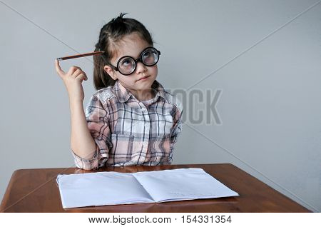 Nerdy Child Thinks About What To Write