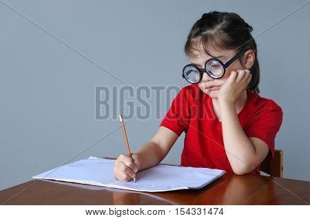 Upset Nerdy Child Doing Homework