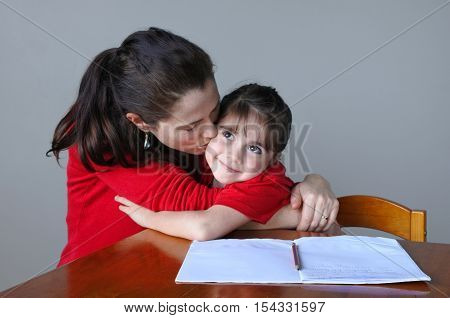 Mother Helping Her Daughter With Her School Project