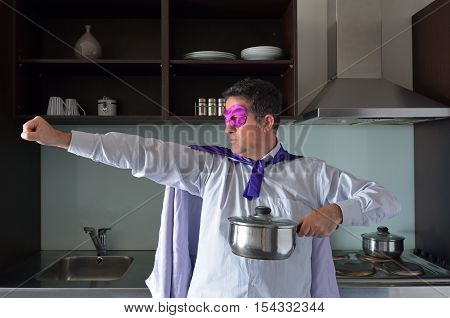 Superhero Father Cooking In Home Kitchen