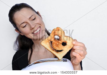 Woman Smile And Holds A Good Slice Of Toast