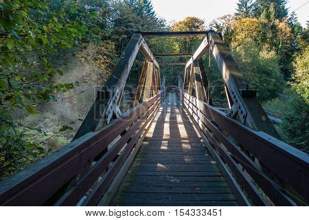 A view of a walking bridge at Tumwater Falls in Washington State.