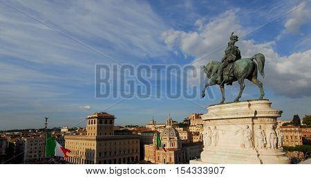 Sunset over the historic center of Rome with the bronze equestrian statue of Vittorio Emanuele King of Italy from Vittoriano monumental altar