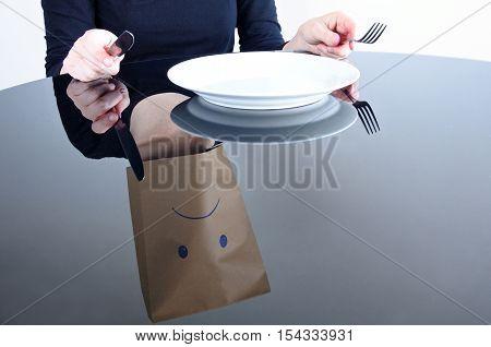Reflection Of Anonymou Sad Woman With Empty Plat