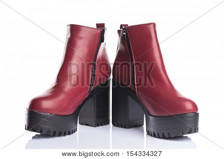 Red autumn boots, isolated on white background