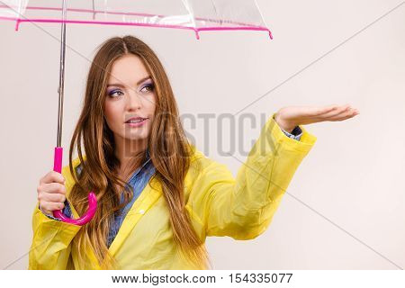 Woman In Rainproof Coat With Umbrella. Forecasting