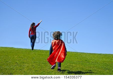 Superhero Mother Show Her Daughter How To Be  A Superhero