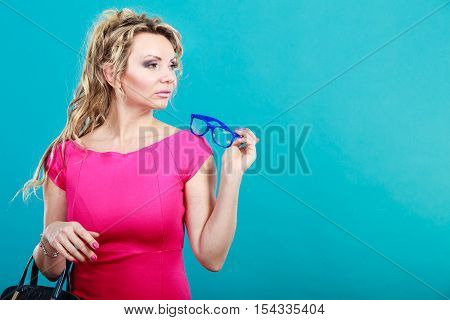Attractive Fashion Woman Holds Glasses