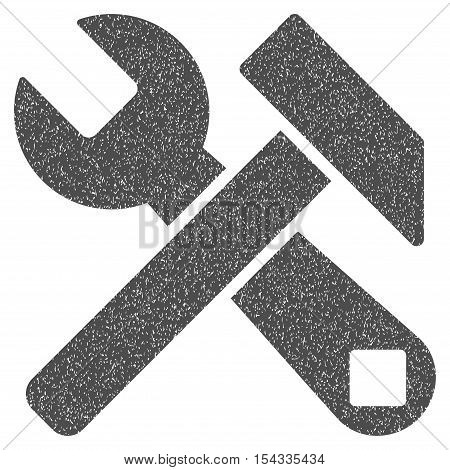 Hammer and Wrench grainy textured icon for overlay watermark stamps. Flat symbol with dust texture. Dotted vector gray ink rubber seal stamp with grunge design on a white background.