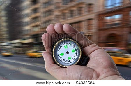 Navigating in the city with a compass in hand.