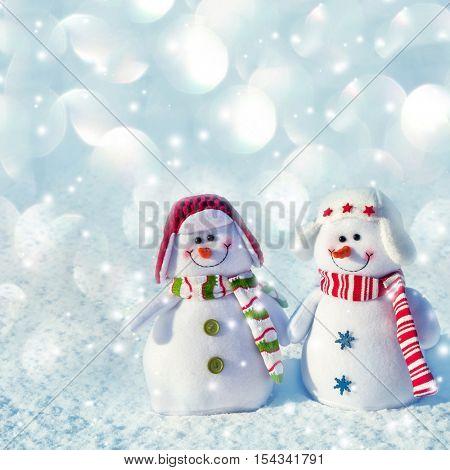 Snowman on snow. Winter wiht snowflake