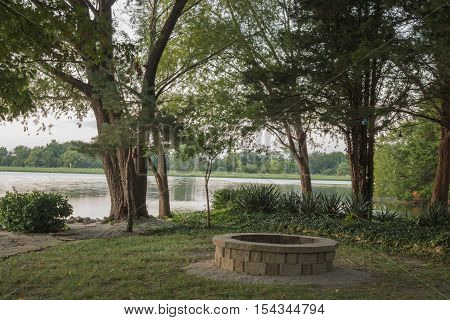 Firepit in a beautiful park on a scenic lakefront in Kansas.