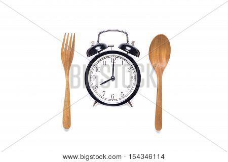 Meal time with alarm clock breakfast on white background