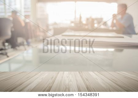 Wood table top with the blurred and Blur Office background.Businessmen blur in the workplace.abstract blur work in office with computer. shallow depth of focus.Advocacy information lab wood size law.