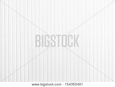 White corrugated zinc texture background. grey metal surface or galvanize steel. fence is made of zinc.