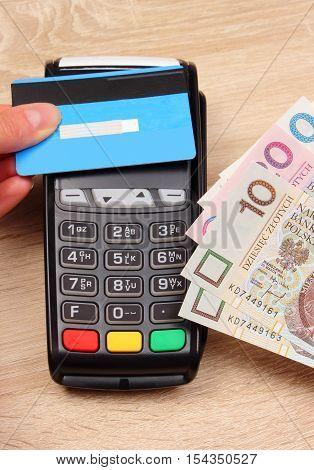 Paying With Contactless Credit Card And Polish Currency Money, Finance Concept
