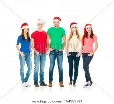 Group of smiling friends in Christmas hats. Young people celebrating New Year together isolated on white background. Friendship, relations, Xmas, X-mas concept.