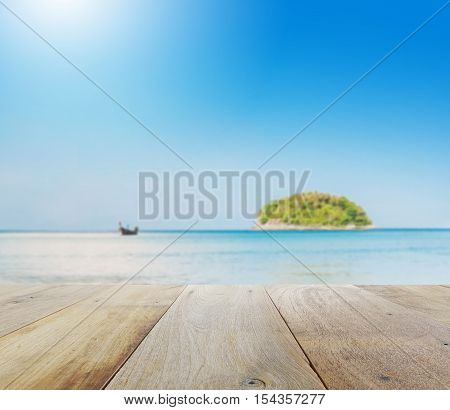 Wooden Table Top With Blur Of Beautiful Seascape With Blue Sea Beach Island And The Long Tail Boat U