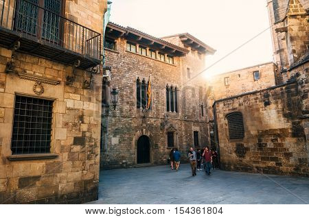 Barcelona Catalunia Spain - May 29 2015: Tourist walk in Gothic quarter of Barcelona in summer at sunset. Crossing the Carrer del Paradis street and Carrer de la Pietat. The area near the Catedral de Barcelona