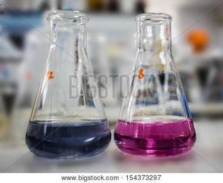 Laboratory Glass Conical Erlenmeyer Flasks Filled With Liquid Chemical