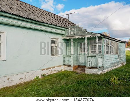 The old wooden house in the village with a verandah in Russia