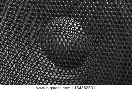 large speaker music loudspeaker with protective grille black. close-up background