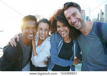 Group of friends enjoying sunset on Brooklyn heights promenade, NYC