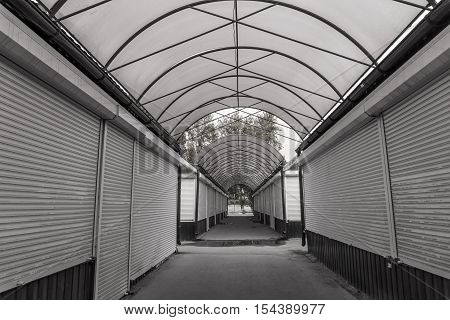 closed shopping arcade, kerbstone market. black and white photo