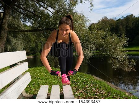 Women tied the laces on sport shoes. Preparing for jogging and exercises