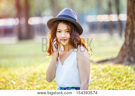 Happy asian woman speaking smartphone outdoor asian beauty