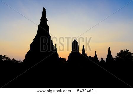 The silhouette scene of the ancient temple in Ayuthaya historical park.The twilight scene at the ancient Buddha temple in Ayuthaya Thailand.