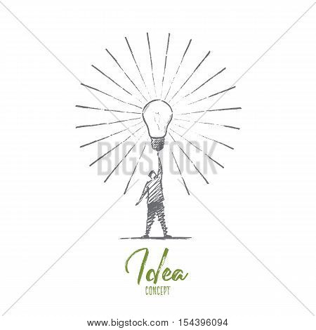 Vector hand drawn Idea concept sketch. Man standing and touching big shining bright light bulb on raised hand meaning getting great idea. Lettering Idea concept