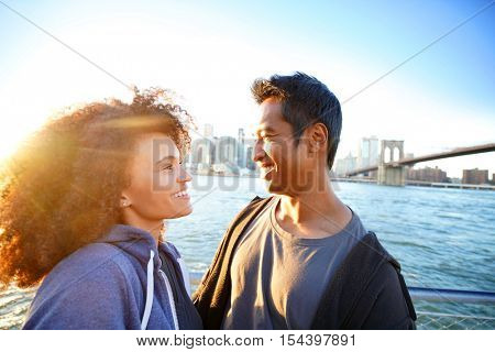 Couple enjoying scenery of Manhattan from Brooklyn Heights at sunset