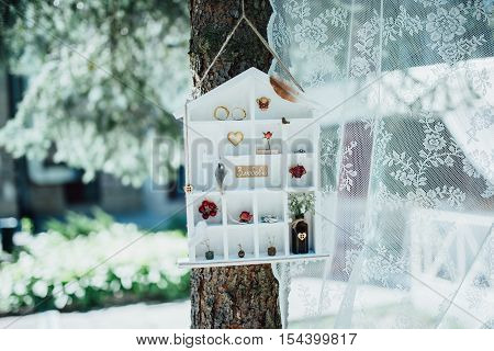 Vintage cottage with decorations and wedding rings on a tree