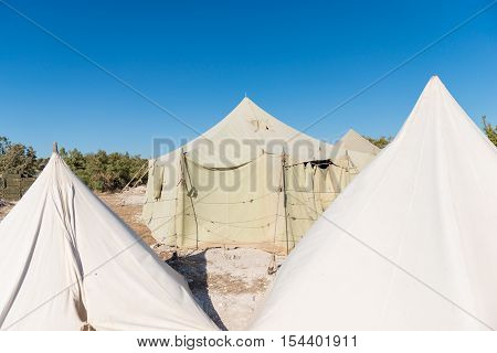 very big military tent in the field with on a bluesky