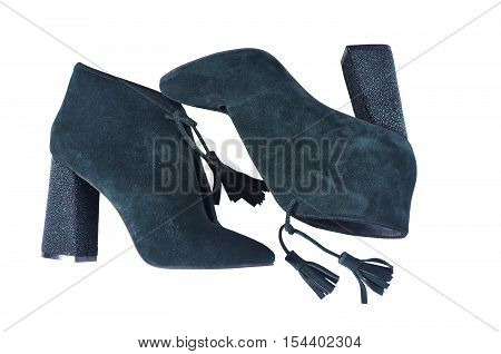 Pair of bright suede shoe with high heels. Sexy women's shoes on a white background. dark green ankle boots isolated on white