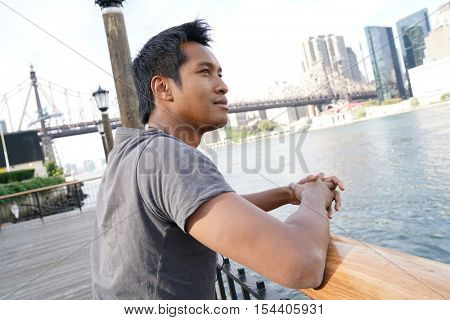 Jogger on Roosevelt Island looking at Manhattan skyline