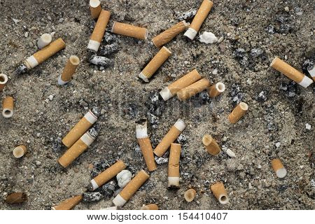 Lots of used cigarette butts as litter