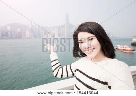 beauty woman selfie and show something to you in hongkong