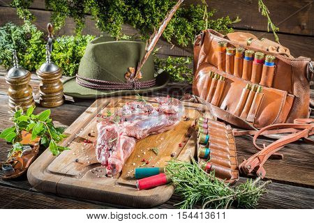 Venison on table of the hunter on old wooden table