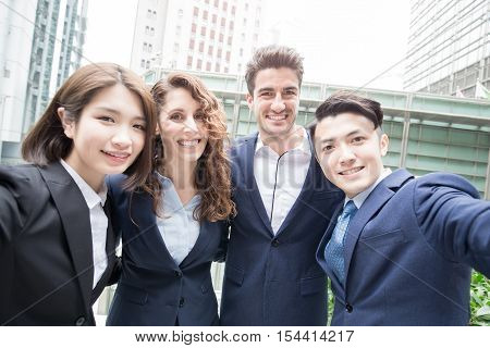 businesspeople are smile happily and selfie in hongkong asian